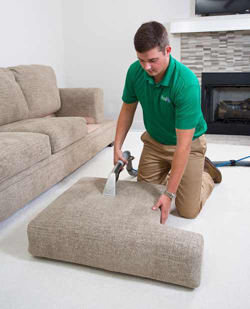 Hampton's Chem-Dry technician providing professional upholstery cleaning in Hannibal & Quincy